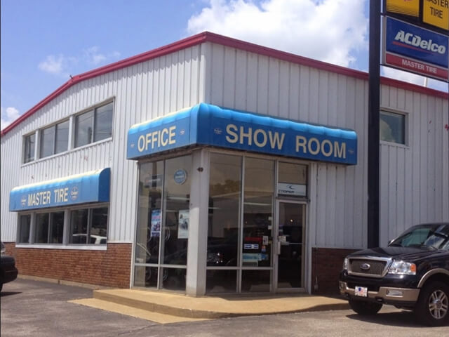 A picture of the showroom entrance to the downtown and main Zeller's Master Tire location.